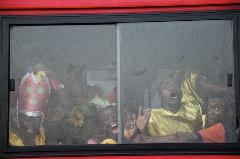 Lagos Carnival: on the way to celebration. People traveling on a public bus to the center of the city.